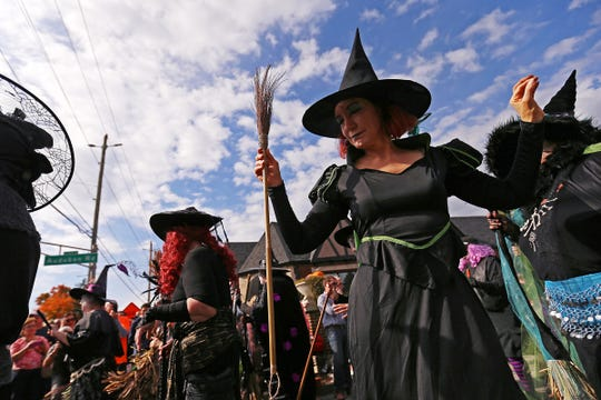 Witches from the Irvington Black Hat Society dance at the intersection of Audubon Road and Washington Street during the 2016 Historic Irvington Halloween Festival.