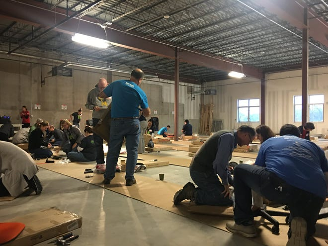 Hills Bank and United Way of Johnson & Washington Counties volunteers build desks for children at St. Andrew's Church Oct. 25, 2019, in Iowa City.