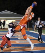 Madison Central's Blake Guner (5) catches a touchdown pass against South Panola on Thursday, October 23, 2019, at Madison Central High School in Madison, Miss.