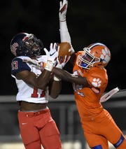 South Panola's Cameron Wright (17) catches a deep pass against Madison Central's Braxton Merritt (32) on Thursday, October 23, 2019, at Madison Central High School in Madison, Miss.