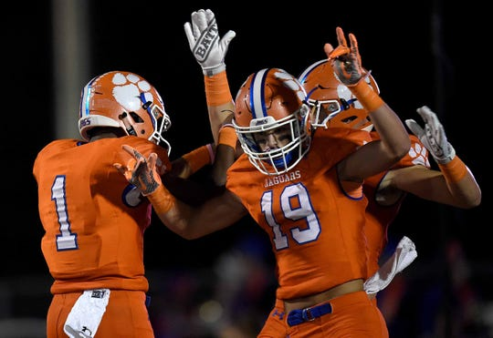 Madison Central's Jimmy Holiday (1) celebrates his touchdown with Ben Davis (19) on Thursday, October 23, 2019, at Madison Central High School in Madison, Miss.
