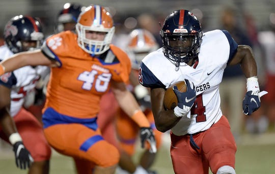 South Panola's Janari Dean (4) runs against Madison Central's Andrew Mack (9) on Thursday, October 23, 2019, at Madison Central High School in Madison, Miss.