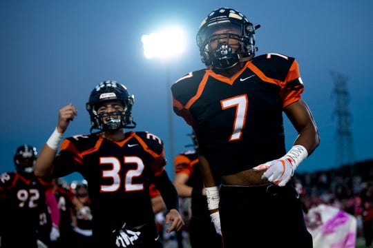Powell's Cannon Lusby (32) and Jordan Brown (7) take the field for the game against Oak Ridge at Powell High School in Powell, Tennessee on Thursday, Oct.  24, 2019.