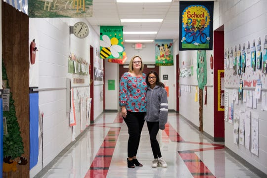 Tonya Cash and her daughter, fifth grader Zoey, pose for a photo at Christenberry Elementary on Oct. 25.