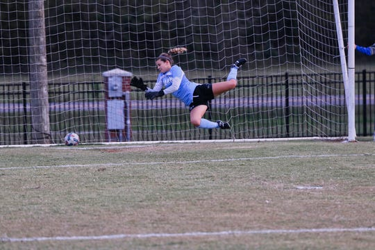 Freshman goalkeeper Emma Cooke guards her turf during the Karns vs Powell semi rounds district tournament held at Powell on Tuesday, Oct. 15.