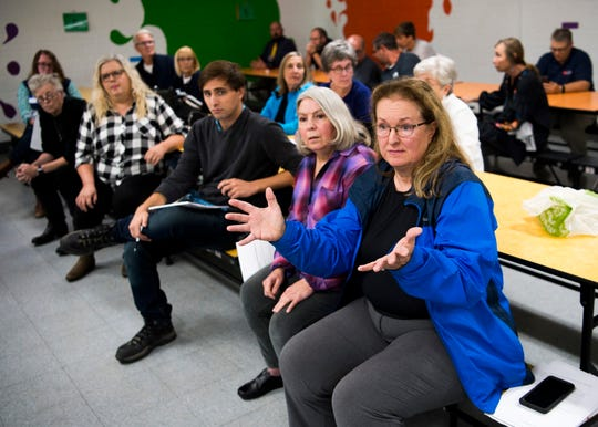 Local residents voice their concerns during a public meeting held at Claxton Elementary School on Thursday, October 24, 2019.