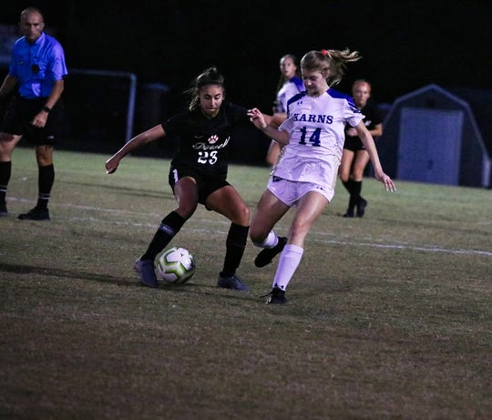 Sophomore midfielder Hannah Stafford attempts to steal the ball during the Karns vs Powell semi rounds district tournament at Powell on Tuesday, Oct. 15.