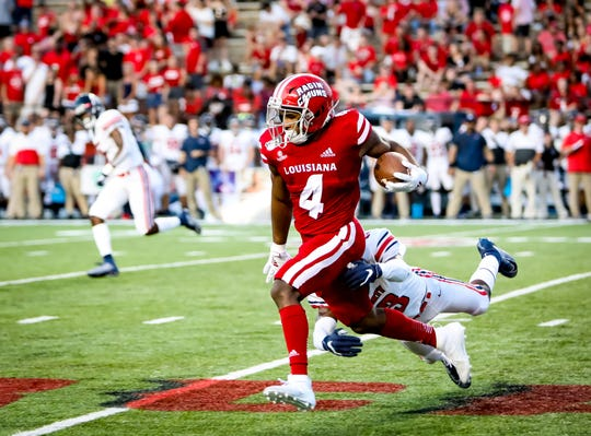 UL RB Raymond Calais gains yardage in the football game between UL and Liberty University at Cajun Field in Lafayette, Louisiana on September 07, 2019.