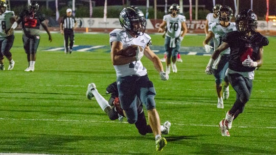 St. Thomas More wide receiver Jack Bech runs in a touchdown against the Northside High Vikings Thursday, Oct. 24, 2019.