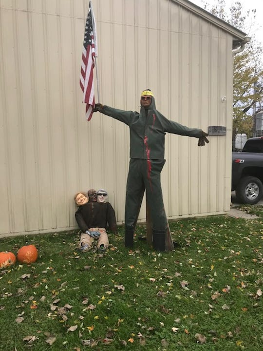 A Halloween display outside of Quality Coatings in Fowlerville.