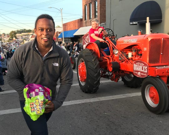 Attorney general candidate Daniel Cameron campaigns with Agriculture Commissioner Ryan Quarles in the 40th Foothills Festival parade in Albany on Oct. 18.
