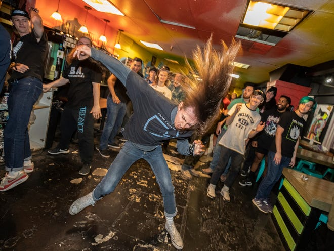 Seth Lewis, a member of the local hardcore band Trangression, moshes  at an Oct. 24 show in Spinelli's Pizzeria in downtown Louisville.