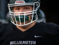 Williamston's Eston Miles walks out of the locker room fore pregame warmups before the Hornets game against Pewamo-Westphalia on Friday, Oct. 25, 2019, in Williamston.