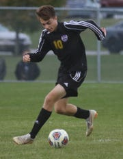 Lexington's Gavin George gave the Minutemen the district championship with his overtime header to defeat Madison 3-2.