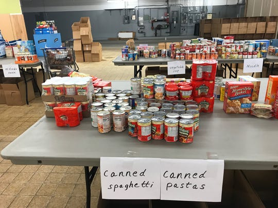 Cans of ravioli and spaghetti were donated to the Make A Difference Day food drive Friday at Graham Automall. The food drive, which continues Saturday, benefits five local food pantries.