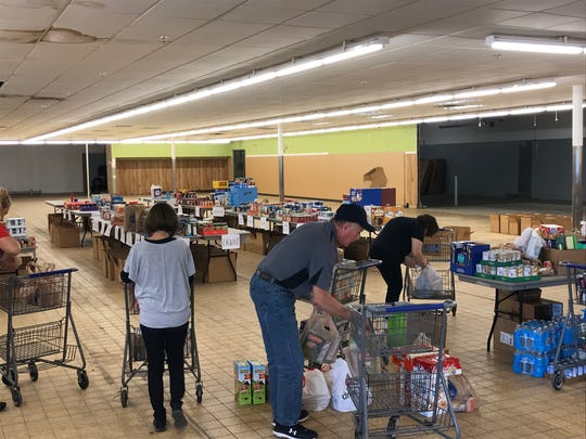 Food donations were dropped off Friday at Graham Chevrolet, 1515 W. Fourth St. and volunteers sorted and boxed them nearby. The food drive continues Saturday.