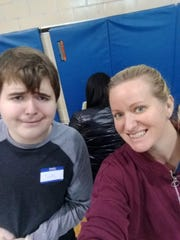 Jude Phillips and his mother Emily Phillips helped serve food during the 2018 Thanksgiving dinner at the rec center in downtown Marion.