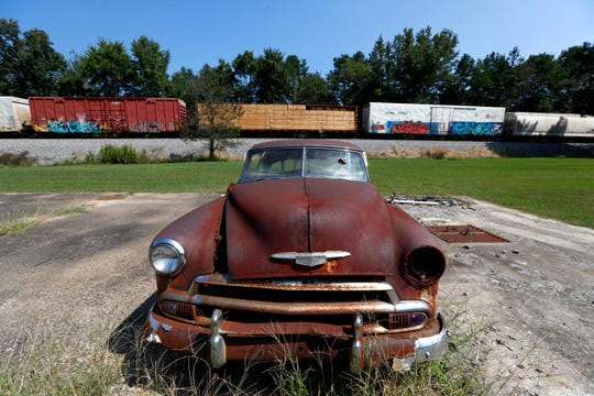 A rusted-out Chevrolet sits along Route 57 entering La Grange, Tenn.