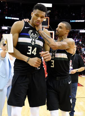 George Hill was one of several Bucks players that had Giannis Antetokounmpo's back after the reigning MVP fouled out of the team's opener against the Rockets on Thursday.