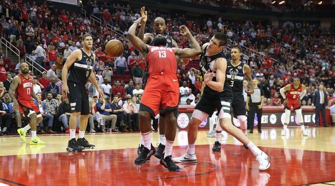 Houston Rockets guard James Harden (13) is fouled by Milwaukee Bucks forward Ersan Ilyasova (7) in the second half at Toyota Center.