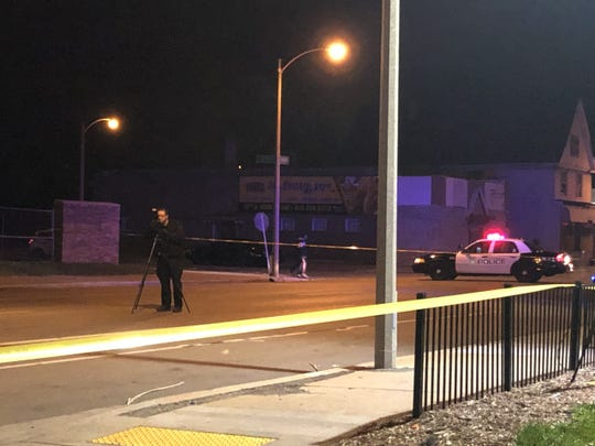 Milwaukee police take photographs at the scene of a hit-and-run accident on West Center and North 22nd streets that killed one child and injured two other children Thursday evening.
