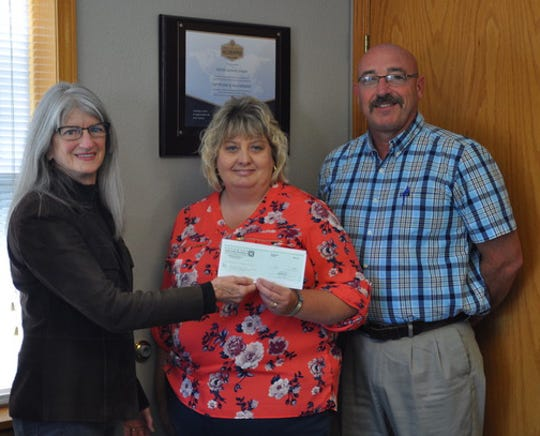 """The Twin Lakes Community Foundation, an affiliate of Arkansas Community Foundation, recently presented a $1,500 a check to Yellville-Summit Elementary to fund """"A Night to Remember in November.""""The grant will fund an elementary school,family reading night from 5-7 p.m. Nov.19, in the Y-S Cafetorium.Students will share books with their families while enjoying a delicious dinner. Pictured are: (from)Judy Loving, TLCF representative; Marilyn Pangle, Yellville-Summit K-12 Curriculum Specialist; and Wes Henderson, Superintendent at Yellville-Summit Public Schools."""