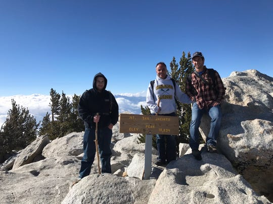 Mark Quadrel stands atop San Jacinto in California with sons Steven (left) and Chris.