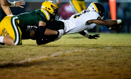 Autauga's  Teddy Harris (4) dives across the goal line for a touchdown against Edgewood at the Edgewood campus in Elmore, Ala., on Thursday evening October 24, 2019.