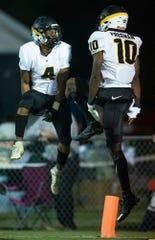 Autauga's  Teddy Harris (4) and Autauga's  Tyreshon Freeman (10) celebrate Freeman's touchdown run against Edgewood at the Edgewood campus in Elmore, Ala., on Thursday evening October 24, 2019.
