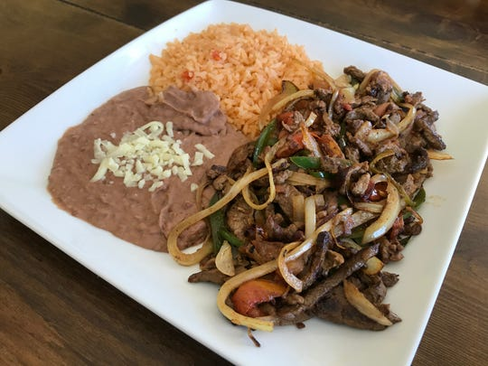 Guiso Mexicano from El Monte features sauteed onions, peppers and tomatoes with certified Angus beef steak, and served with house-made beans and rice.