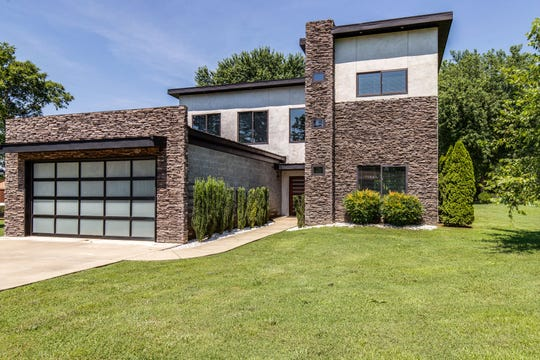 Brandon Reed's California contemporary house has a four-car garage in front.