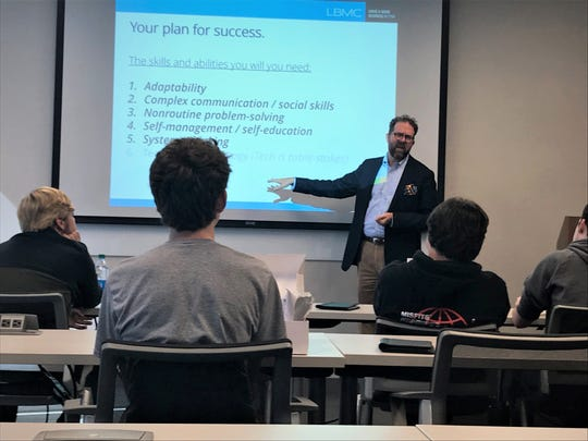 John Dunavan, LBMC director of learning and development, delivers a presentation to Summit High School students, about 21st century work skills during Traveling Tech Day on Wednesday.