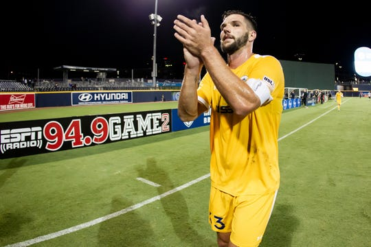 Nashville SC center back and captain Forrest Lasso applauds fans at First Tennessee Park, Oct. 8, 2019.