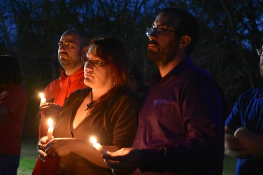 Theresa Marsh and Carl Grammatico mourn the loss of a colleague at a candlelight vigil in memory of Roy A. McCombs, 55, a resident of Columbia, who was killed after being hit by a car Tuesday morning outside the General Motors plant in Spring Hill amid an ongoing strike.