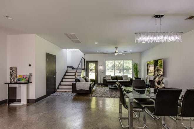 The interior features polished concrete floors and neutral paint.