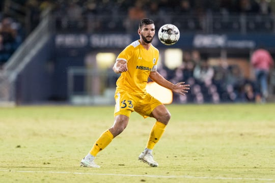 Nashville SC center back Forrest Lasso makes a pass up field against Atlanta United 2, Oct. 19, at First Tennessee Park.