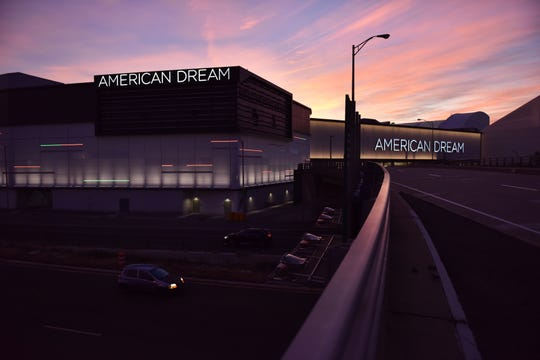 The sun rises over American Dream on its opening day in East Rutherford, N.J.,  on Friday, Oct. 25, 2019.