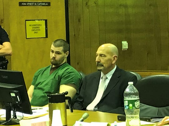 Jason Vanderee with his attorney, John Latoracca, on Friday.