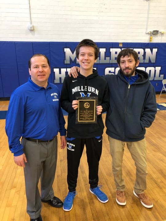 Hunter Friederichson, pictured with high school coach Marc Lombardy and middle school coach Greg Pollock, has received an outpouring of support for his request to join the high school wrestling team as a homeschooled student. The board declined to adjust its policy during its early October meeting.