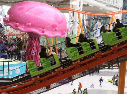 Riders on the Nickelodeon Slime Streak during opening day for Nickelodeon Universe at American Dream, a retail mall and entertainment park in East Rutherford, N.J., Friday, Oct. 25, 2019.