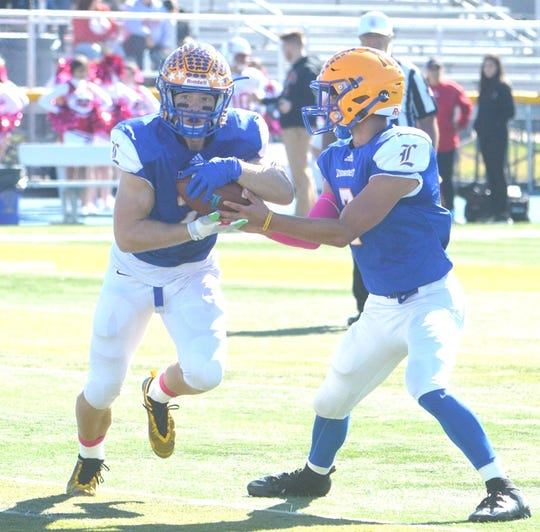 Lyndhurst running back Piotr Partyla taking a handoff from quarterback Anthony Lembo against Elmwood Park.