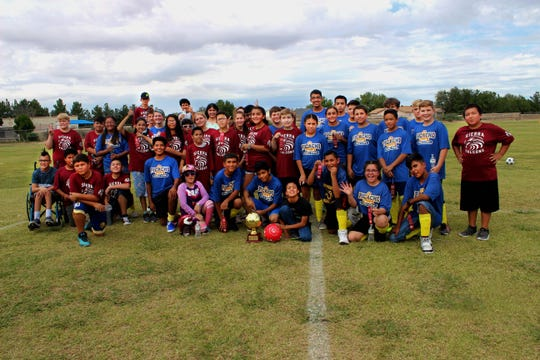 Picacho Middle School students unify with Sierra Middle School students for a group photo after the game.