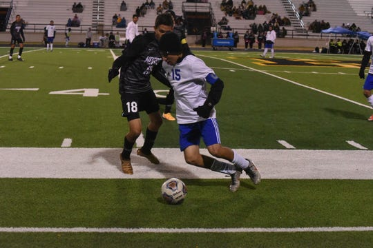 Carlsbad midfielder Nate Martinez tries to get around Hobbs defender Alan Carreon in the second half at Watson Memorial Stadium Thursday night.