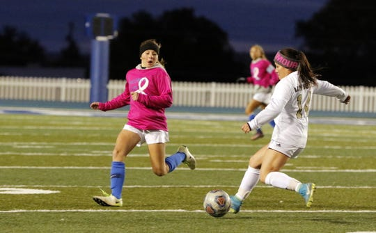 Carlsbad's Faith Aragon runs down Hobbs' Jasmine Martinez during their match on Oct. 24, 2019. Carlsbad won, 2-1 to claim the district title.