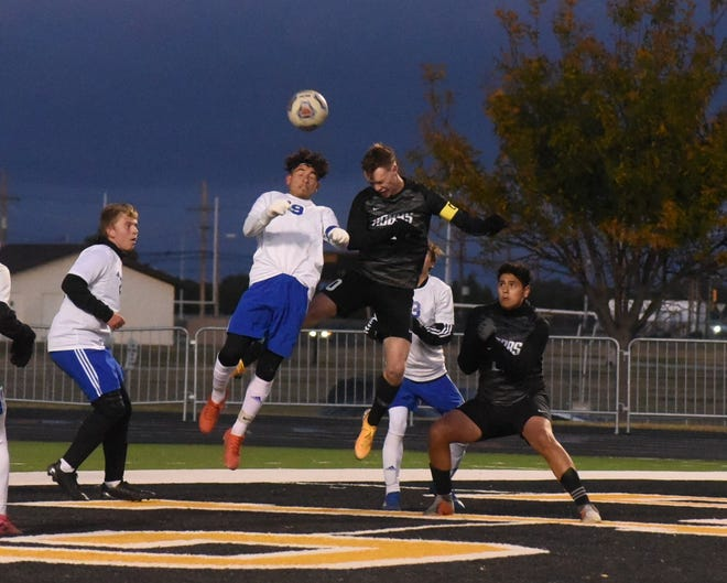 Hobbs Keaton Hartman (right) and Carlsbad Jesus Zamora both go for a header on a corner kick in the first half Thursday night. The Eagles defeated the Cavemen 5-0 in a District 4-5A game.