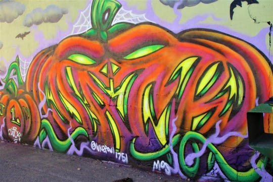 A Luke Paul mural of an elaborate jack-o'-lantern is painted on the north side of the building that houses the GC Harvest Church at 308 W. Broadway Ave. in downtown Farmington.