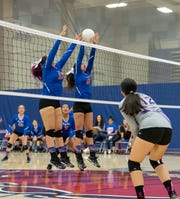 Amay Rodriguez (9) and Amanda Aguilera (13) of Indio at the net during Thursdsay's playoff victory.