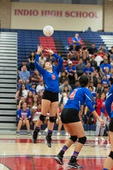 Alexis Zepeda of Indio setting a returm during Thursday night's playoff game against Vista del Lago.