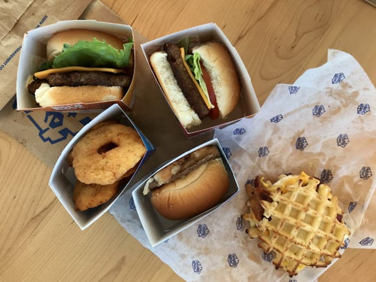We tried a selection of items from the menu at Arizona's first White Castle including the Original Slider, the 1921 Slider, a Breakfast Slider, an Impossible Slider and chicken rings.