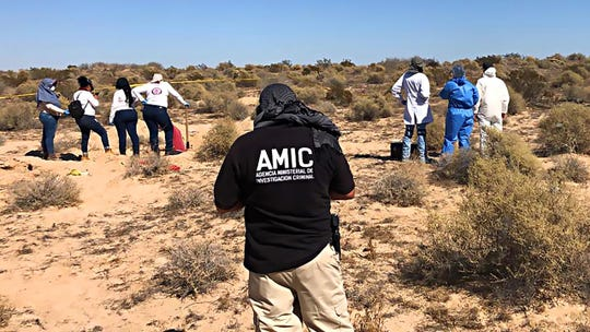 Women with the Mexican group Searching Mothers of Sonora, joined by state investigators, dig up a mass grave on Oct. 24, 2019, outside the popular beach town of Rocky Point.